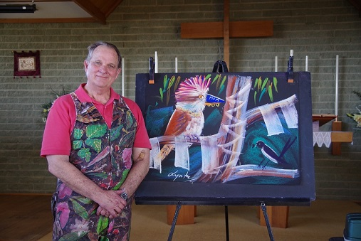 Lynton with the finished Sketch of Kooki - a story of God's love, forgiveness and invitation to be part of His family
